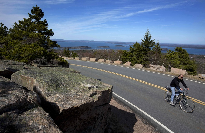 A bicyclists peddles up the road to the summit of Cadillac Mountain on Thursday at Acadia National Park.