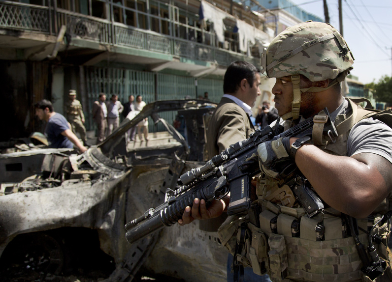 A U.S. soldier arrives to the scene where a suicide car bomber attacked a NATO convoy in Kabul, Afghanistan on Thursday.