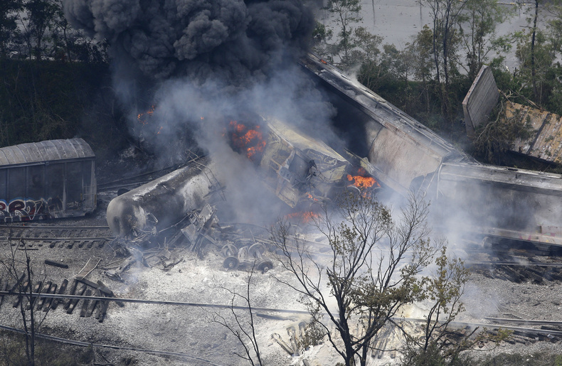 A fire burns at the site of a CSX freight train derailment Tuesday in White Marsh, Md., where fire officials say the train crashed into a trash truck, causing an explosion that rattled homes at least a half-mile away.