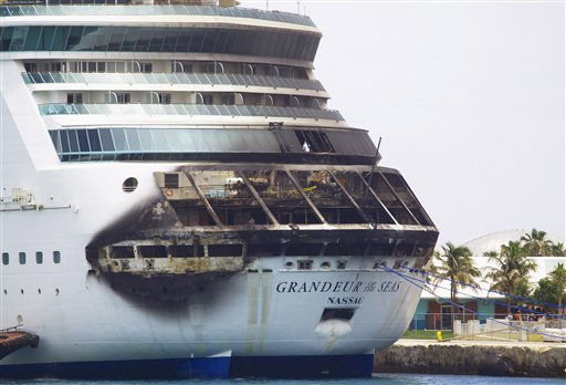 The fire-damaged exterior of Royal Caribbean's Grandeur of the Seas cruise ship is seen while docked in Freeport, Grand Bahama island on Monday. All 2,224 guests and 796 crew were safe and accounted for.