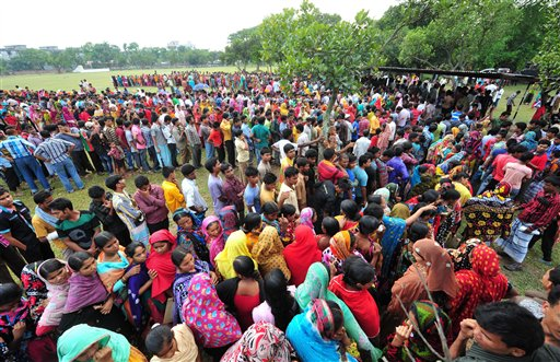 Garment workers employed at Rana Plaza, the garment factory building that collapsed, queue up to receive wages from the Bangladesh Garment Manufacturers and Exporters Association in Savar, Bangladesh.