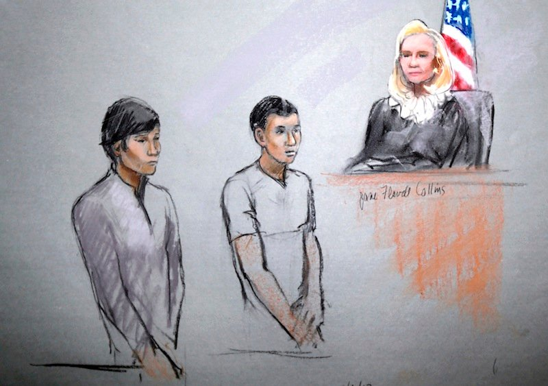 This courtroom sketch signed by artist Jane Flavell Collins shows defendants Dias Kadyrbayev, left, and Azamat Tazhayakov appearing in front of Federal Magistrate Marianne Bowler at the Moakley Federal Courthouse in Boston, Mass., Wednesday, May 1, 2013. The two college friends of Boston Marathon bombing suspect Dzhokhar Tsarnaev, and another man, were arrested and charged with removing a backpack containing hollowed-out fireworks from Tsarnaev's dorm room. (AP Photo/Jane Flavell Collins)