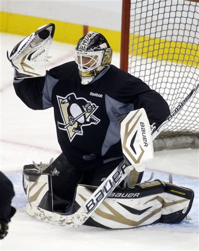Pittsburgh Penguins goalie Tomas Vokoun stops a shot during the NHL hockey practice on Friday, May 31, 2013 in Pittsburgh. The Penguins are preparing for the Stanley Cup Playoff series against the Boston Bruins scheduled to start in Pittsburgh on Saturday.