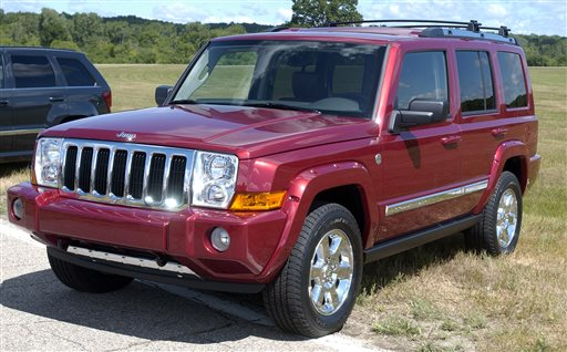 A 2006 Jeep Commander sits on display at Chelsea Proving Grounds in Chelsea, Mich. Chrysler is recalling 469,000 Jeep SUVs worldwide because they can shift into neutral without warning, the company announced Saturday.