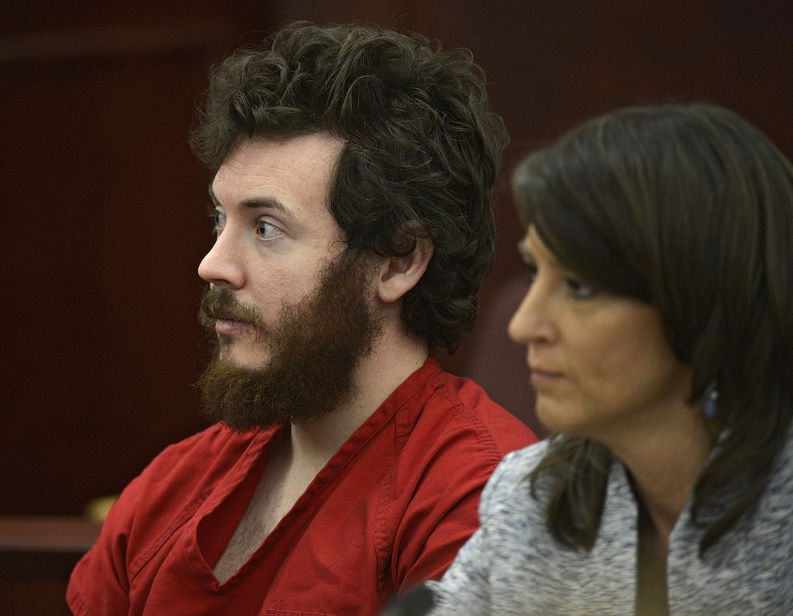 James Holmes, who is accused of opening fire in a Colorado movie theater, sits next to defense attorney Tamara Brady in district court in Centennial, Colo., on March 12.