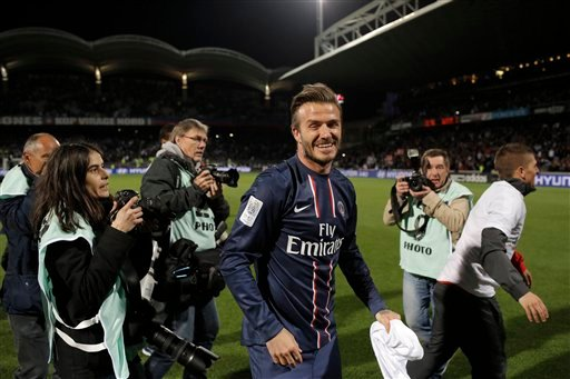 Paris Saint-Germain's David Beckham celebrates his team's victory in a French League One soccer match against Lyon, in Lyon, France, on Sunday.
