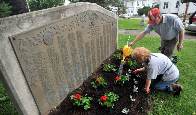 Louie and Linda Huard plant fresh flowers and plants at Veterans' Memorial Park in Waterville on May 25, 2012.