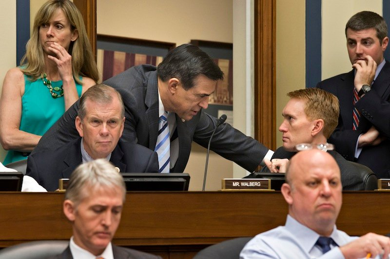 House Oversight and Government Reform Committee Chairman Rep. Darrell Issa, R-Calif., center, leans over to speak with Rep. James Lankford, R-Okla., on Capitol Hill in Washington, Wednesday, May 22, 2013, during the committee's hearing to investigate the extra scrutiny the Internal Revenue Service gave Tea Party and other conservative groups that applied for tax-exempt status. Rep. Scott DesJarlais, R-Tenn., is at lower right, and Rep. Trey Gowdy, R-SC, is at lower left. Rep. Tim Walberg, R-Mich., listens at center left. (AP Photo/J. Scott Applewhite)