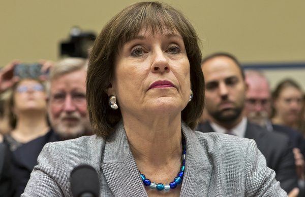 In this May 22, 2013, photo, Lois Lerner listens on Capitol Hill in Washington. A day after she refused to answer questions at a congressional hearing, Lerner has been replaced as director the Internal Revenue Service division that oversaw agents who targeted tea party groups. Danny Werfel, the agency's new acting commissioner, told IRS employees in an email Thursday, May 23, 2013, that he has selected a new acting head of the division, staying within the IRS to find new leadership. (AP Photo/J. Scott Applewhite)