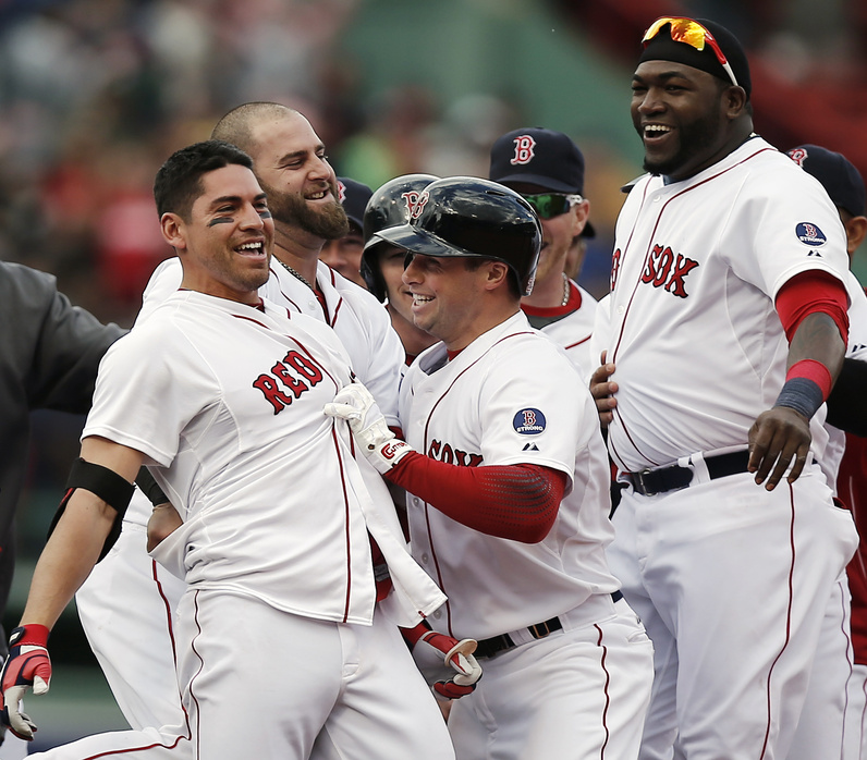 Jacoby Ellsbury, left, is mobbed by Red Sox teammates including Stephen Drew, center, and David Ortiz, right, after his game-winning walk-off two-run double in the ninth inning of Boston's 6-5 win over the Cleveland Indians at Fenway Park on Sunday.