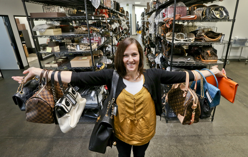 Sarah Davis, co-owner of Fashionphile.com, poses with her bags in a company warehouse in the Carlsbad, Calif. The Internet company sells rare, vintage, and discontinued previously owned bags and is facing the complicated task of dealing with new state regulations on Internet sale taxes.