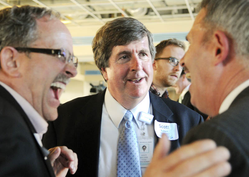 Norm Elvin, left, and Mark Johnston, right, congratulate former MaineGeneral CEO Scott Bullock, center, after a building of the new hospital campus was named in his honor on Tuesday at a ceremony in Augusta. The Scott B. Bullock Medical Office Building will be part of the new, regional hospital.