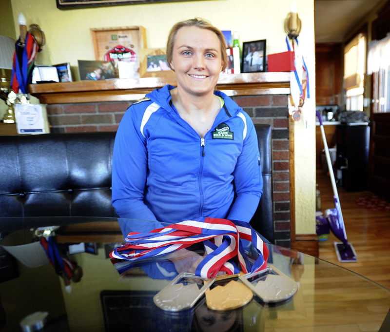 Luge Olympian Julia Clukey at her home in Augusta displays her latest medals from the Lake Placid World Cup from February 2013.