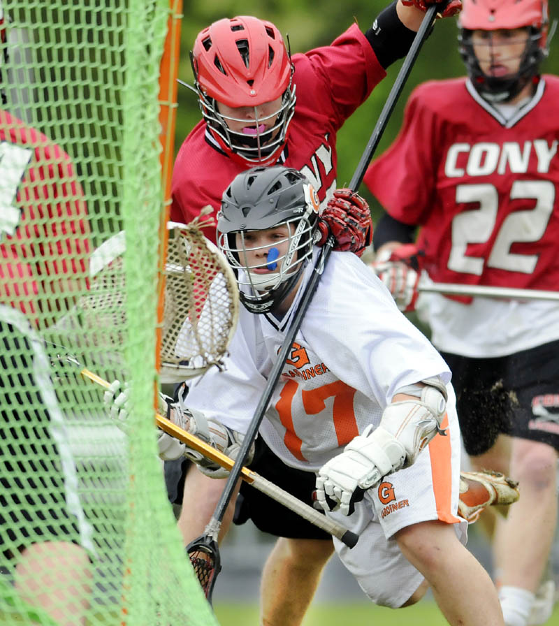 TAKING THE SHOT: Gardiner Area High School's Dalton Sargent takes a shot during the Tigers' 12-3 win over Cony in boys lacrosse action Wednesday in Gardiner.