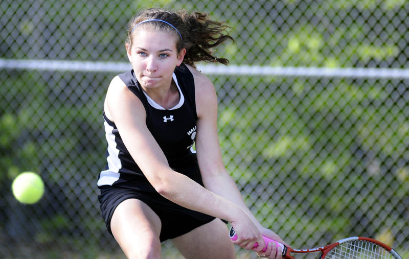 Hall-Dale High School's Clio Barr returns a serve to Dirigo High Schoo's Addy Fuller during a match Monday in Farmingdale. Barr won 6-2, 6-4. Hall-Dale won the match 4-1. For more tennis, see C4.