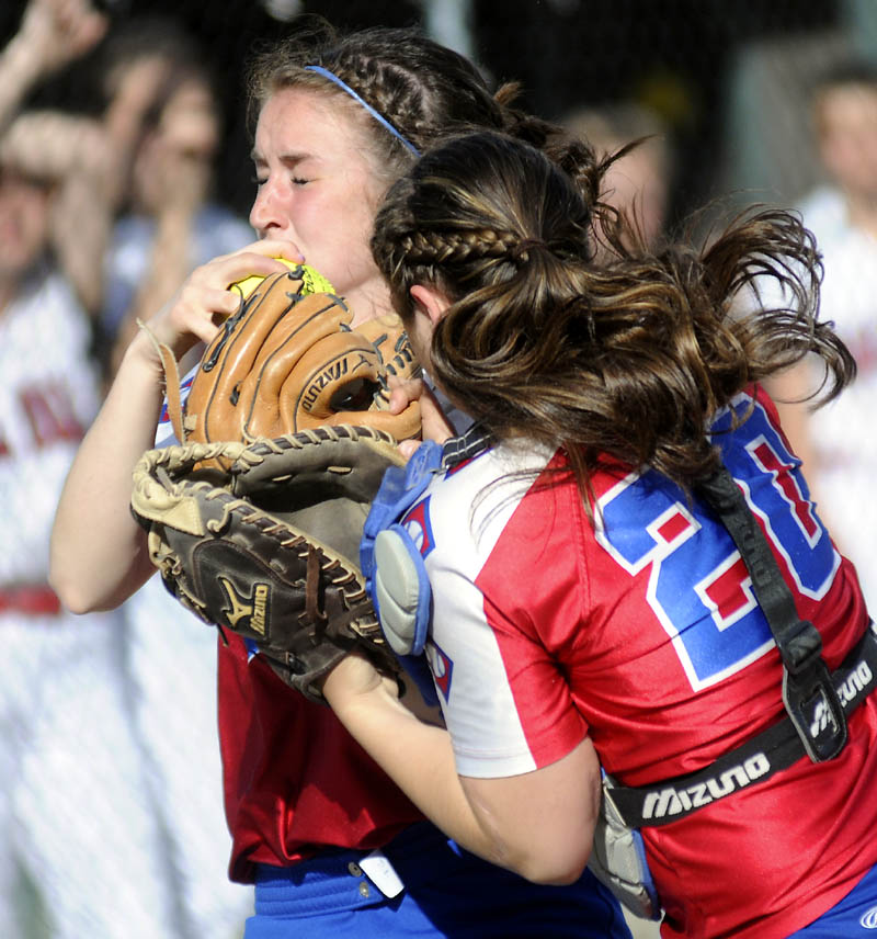 LOOK OUT: Oak Hill High School's Brooke LeBel, right, and Sadie Goulet collide while chasing a foul ball at home plate during the Raiders' 3-1 win over Hall-Dale on Wednesday in Farmingdale.