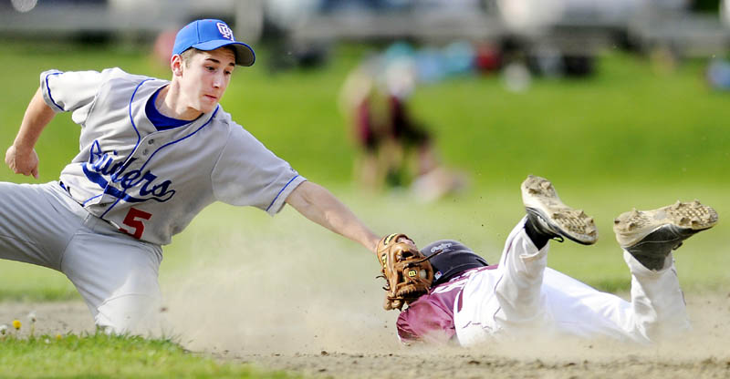 YOU'RE OUT: Monmouth Academy's Devin West gets tagged out at second base by Oak Hill High School's Brady Dion on Tuesday in Monmouth.