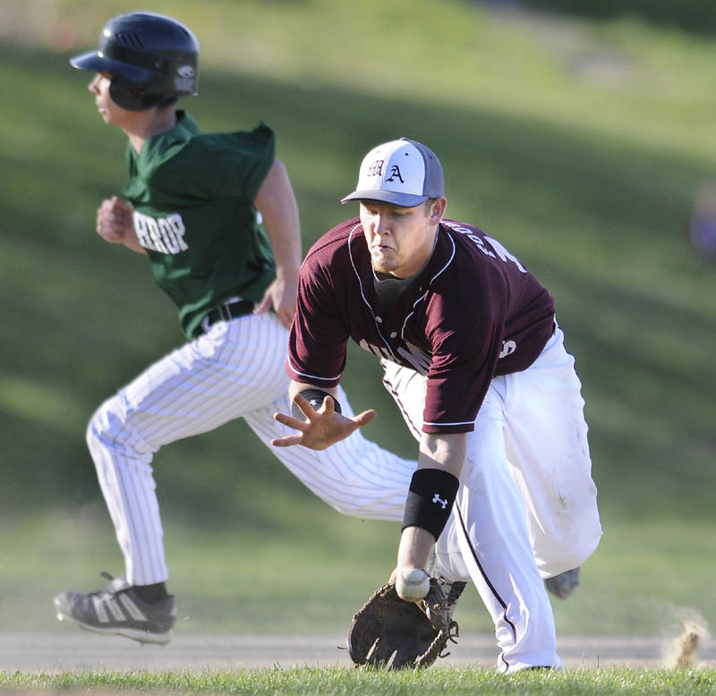GOOD GRAB: Monmouth's Josh Fournier fields a grounder at third base against Winthrop on Monday in Monmouth.