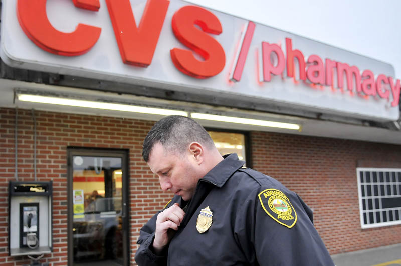 Augusta Police Dept. Lt. Christopher Massey speaks on the radio moments after arriving at the CVS Pharmacy on Capitol Street in Augusta in November of 2012. Statistics released Wednesday by the Maine Department of Public Safety indicate that robberies increased year over year, with 56 pharmacy robberies in Maine last year.