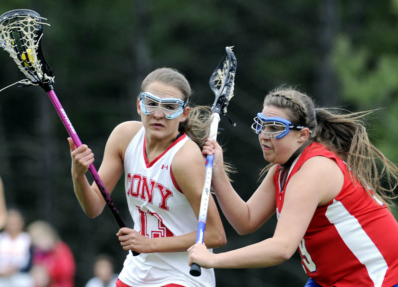 TOUGH D: Cony High School's Hayley Quirion, left, is checked by Messalonskee High School's Abby Roberts on Tuesday in Augusta. The Eagles beat the Rams 11-4.