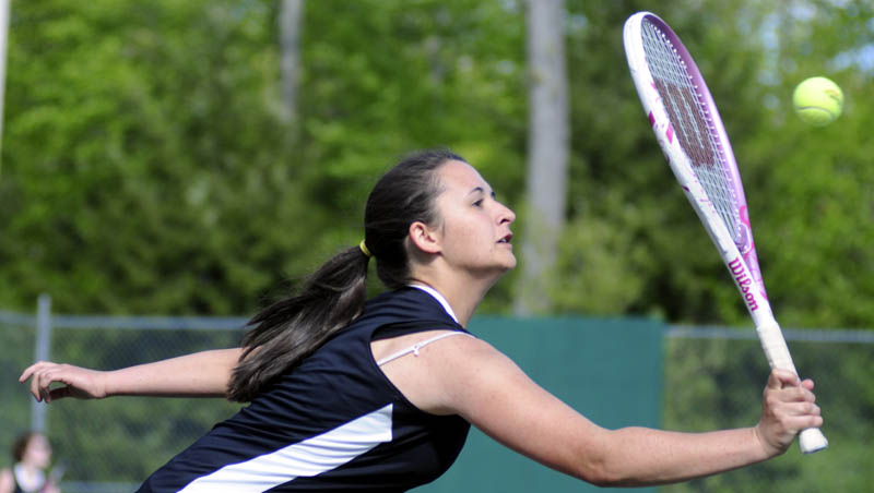 BACK TO YOU: Hall-Dale's Danielle Brosseau returns a serve during a doubles match against Dirigo on Monday in Farmingdale. Dirigo won the match 4-6, 6-3, 6-4. Hall-Dale earned the team win 4-1.