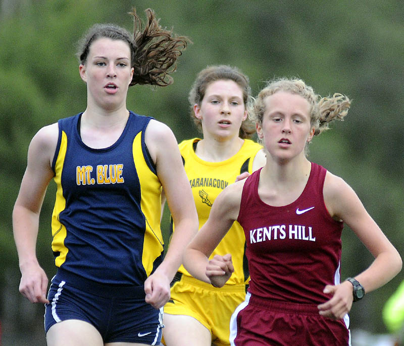 Kents Hill School's Anne McKee, right, pulls ahead of Mt. Blue High School's Miranda Nicely, left, and Maranacook Community School's Caroline Colan in the 1,600-meter run Thursday in Readfield. McKee won the race in 5 minutes, 28.16 seconds. Nicely finished second (5:29.75) and Colan was third (5:36.44).