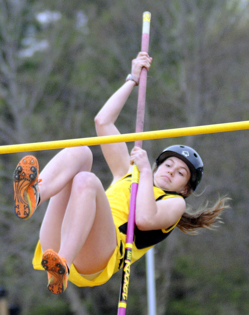 UP AND OVER: Maranacook Community School's Taylor Cray clears the 6-foot bar in the pole vault Thursday during a track and field meet in Readfield. Cray finished fifth with a leap of 6-6. Messalonskee's Taylor Lenentine was first with a vault of 9-0. For complete results, see C6.
