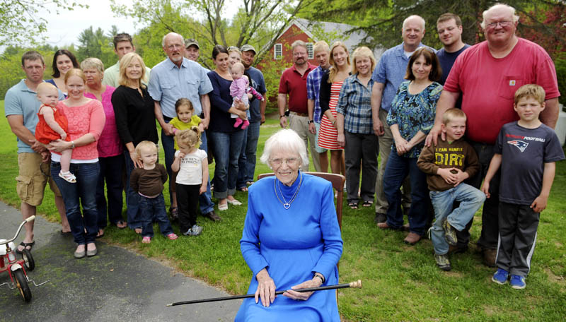 Priscilla Stevenson, 95, is surrounded by three generations of her children outside her Wayne home, after she received the Wayne Cane Sunday, given to the town's oldest resident.