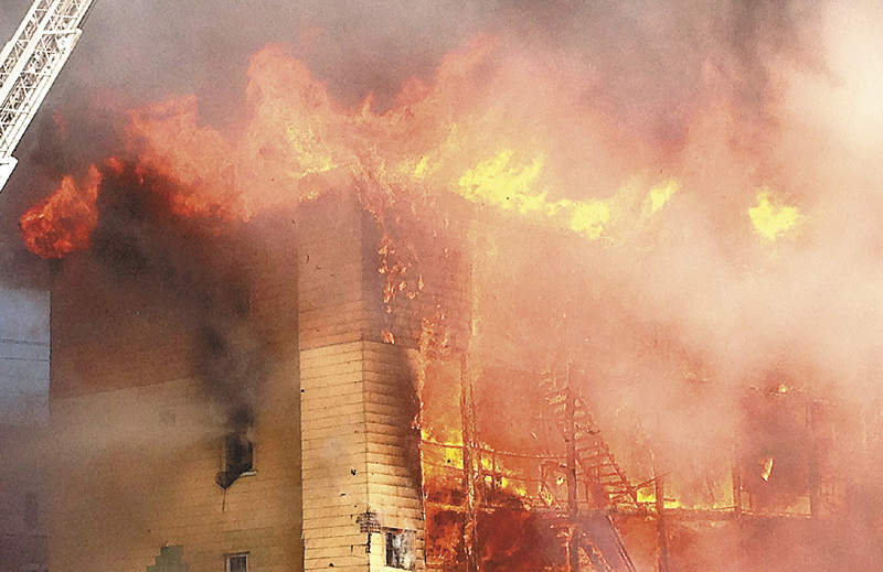 Fire consumes an apartment building in Lewiston on Monday. At least four apartment buildings were involved, with many more in peril. LEWISTON;FIRE;BLAKE STREET;BATE