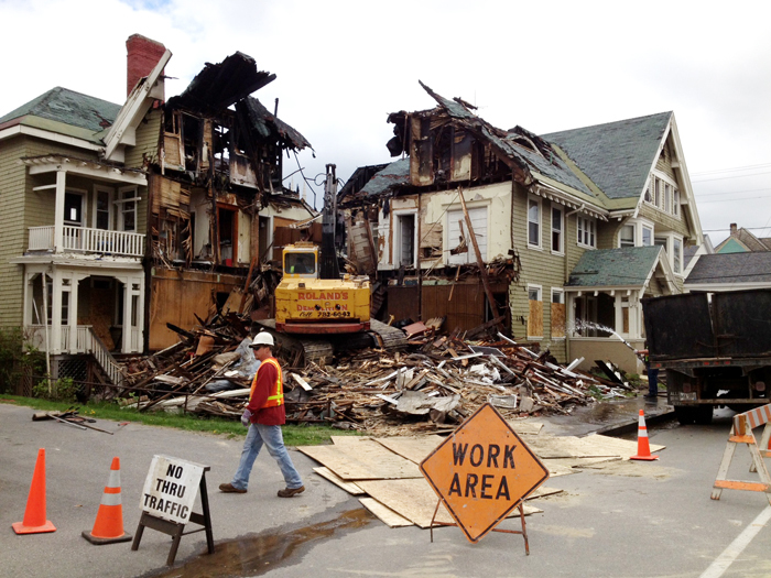 Crews demolish a building at 80-82 Pine St. in Lewiston on Friday. In all, five buildings will be demolished by the end of the day Friday and three buildings will be taken down on Monday, said Gil Arsenault, the city's code enforcement officer.