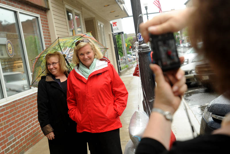 Rep. Chellie Pingree pauses for a picture with Pamela Trinward on Main Street during a walking tour of downtown Waterville Wednesday.