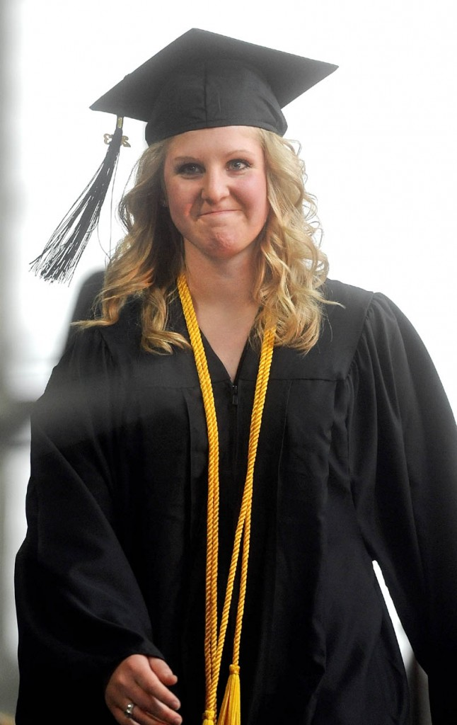 Shelby Gilcott waits for name to be called to accept her diploma during Thomas College's 119th commencement ceremony in Waterville on Saturday.