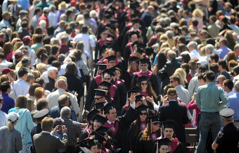 University of Maine at Farmington graduates march to their seats during commencement ceremonies in Farmington on Saturday.