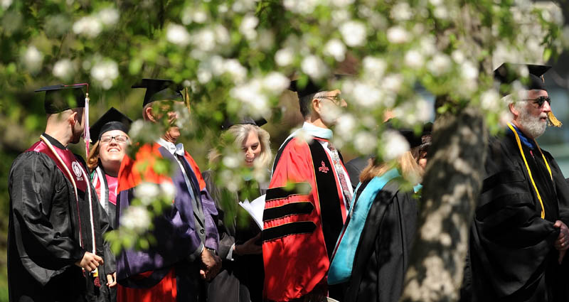 aculty and staff of the University of Maine at Farmington lead the procession during commencement ceremonies in Farmington on Saturday.