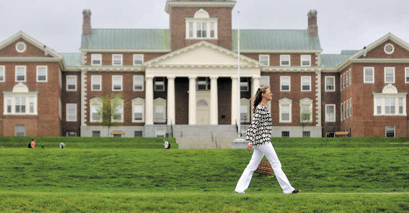 Gina Colombatto, 57, of Waterville, walks along Mayflower Hill Road at Colby College enroute to a friend's home on Thursday. Colombatto has traded in her automobile for walking shoes.