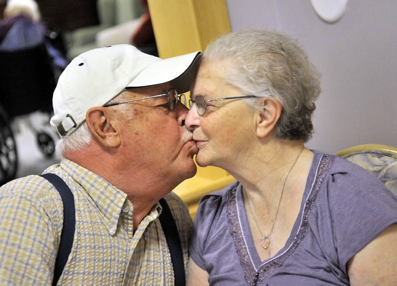 Jake Ellis kisses his wife of 62 years, Pauline Ellis, at Lakewood Nursing Home, a ritual he says he never misses. Jake has seen a great improvement in his wife's mood and happiness since being taken off of her antipsychotic medication.