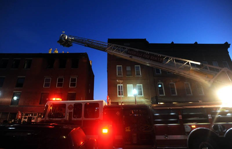 Firefighters battle a blaze in downtown Waterville Friday.