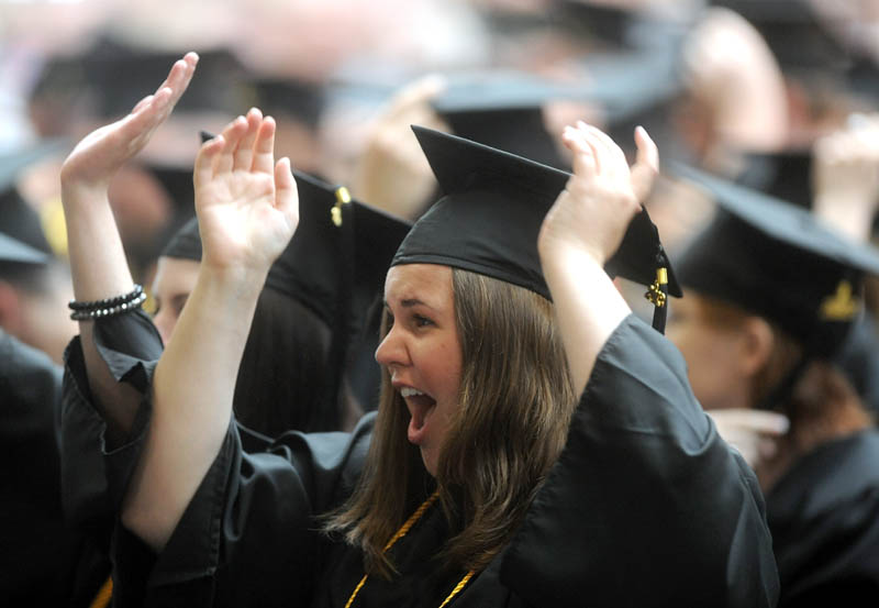 Rachel Clark celebrates with the class of 2013 at Thomas College's 119th commencement ceremony in Waterville on Saturday.
