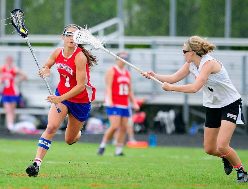 VISION TROUBLE: Messalonskee's Kristy Bernatchez, left, tries to get past Gardiner's Emma Hickey on Thursday at Hoch Field in Gardiner. The Eagles beat the Tigers 17-9.