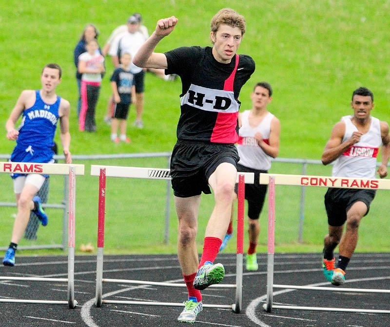 FULL SPRINT: Hall-Dale hurdler Sam Shepherd runs the 300 meter hurdles during Mountain Valley Conference track and field championship Thursday at Alumni Field in Augusta.