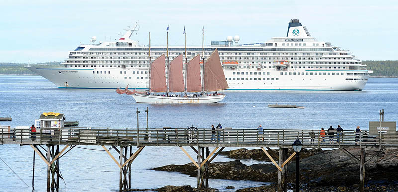 The Margaret Todd, a 151-foot-long, four-masted schooner, is dwarfed by the anchored, 51,000-ton Crystal Symphony cruise liner in Bar Harbor on Monday.