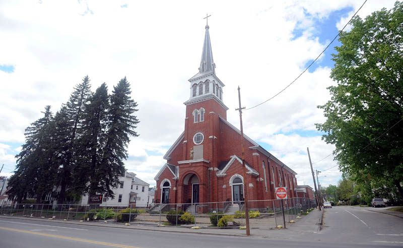 St. Francis de Sales Catholic Church, its rectory and its parish hall, on Elm Street in downtown Waterville, are being demolished this week to make way for a housing project.