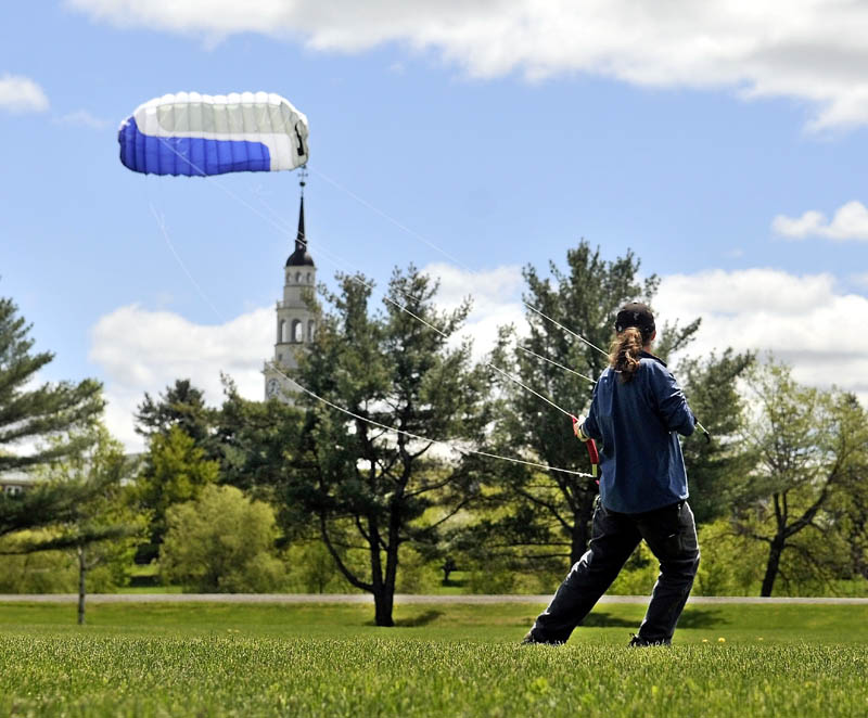 Dan LaRochelle, of Waterville, takes advantage of the blustery weather with his 9-foot quad-line kite on the fields at Colby College on Friday.