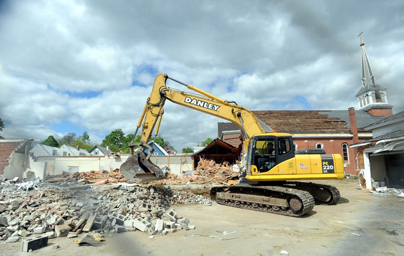 An excavator works during demolition of St. Francis de Sales Catholic Church, its rectory and its parish hall, on Elm Street in downtown Waterville on Tuesday.