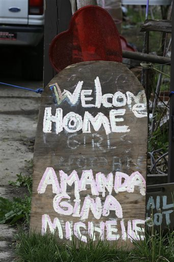 A sign responding to the return of three women held captive for years rests in front of a home Saturday in Cleveland.
