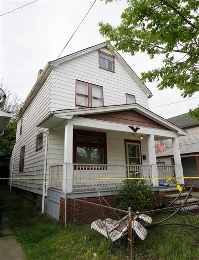 Amanda Berry, Gina DeJesus and Michelle Knight, who went missing separately about a decade ago, were found in this house just south of downtown Cleveland and likely had been tied up during years of captivity, said police, who arrested three brothers.