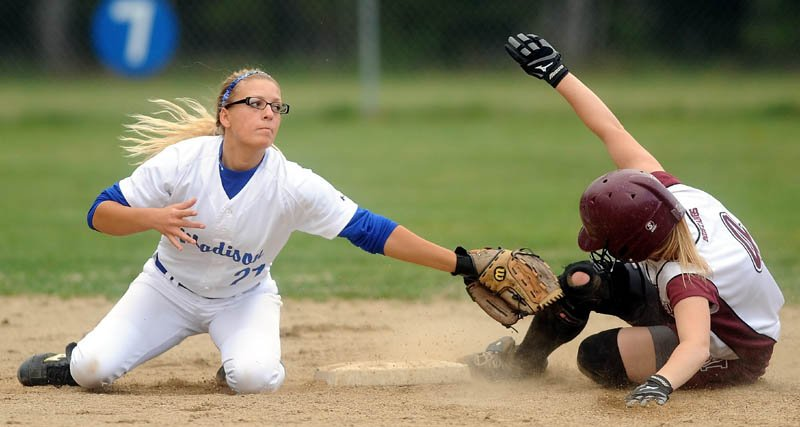 SAFE: Monmouth Academy's Kylie Kemp, right, slides safely into second base ahead of the tag by Madison Memorial High School's Kayla Booker on Friday in Madison.