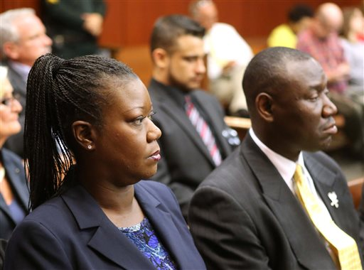 Sybrina Fulton, the mother shooting victim Trayvon Martin, sits with with her attorney Benjamin Crump, during a pretrial hearing on Tuesday for George Zimmerman, the accused shooter of Trayvon Martin.