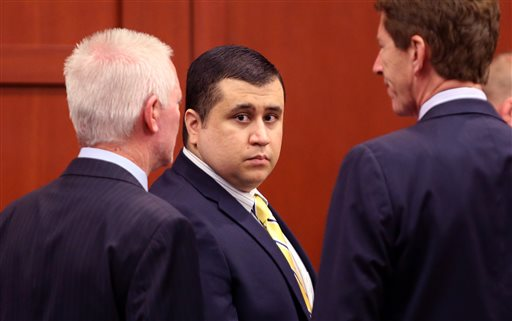 George Zimmerman, defendant in the killing of Trayvon Martin, arrives with his attorney Mark O'Mara, right, for a pretrial hearing on Tuesday in Seminole circuit court, in Sanford, Fla.
