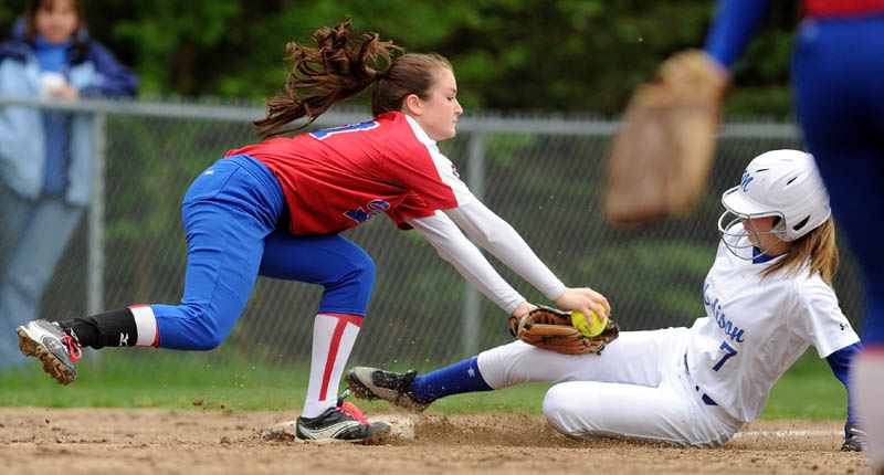 SLIDE INTO THIRD: Madison's Kirstin Wood slides under the tag of Oak Hill third baseman Sadie Goulet on a stolen base attempt during the Bulldogs' 5-3 win Wednesday in Madison.